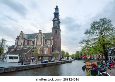 Amsterdam, Netherlands - May 6, 2015: People at Westerkerk (Western Church) a Dutch Protestant church in central Amsterdam in the Netherlands. on May 6, 2015.
