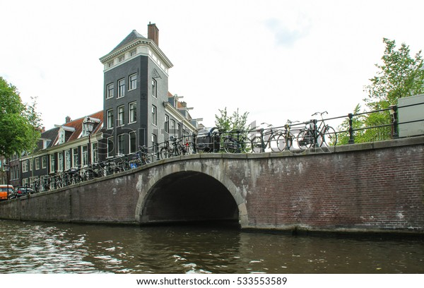 Amsterdam, Netherlands - May 7, 2014: Traditional old houses and boats on Amsterdam canal