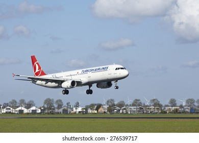 AMSTERDAM, THE NETHERLANDS - MAY, 7. An Airbus A321-231 of Turkish Airlines lands at Amsterdam Airport Schiphol (The Netherlands, AMS) on May 7, 2015. The name of the runway is Polderbaan.