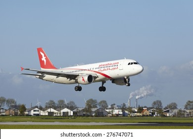 AMSTERDAM, THE NETHERLANDS - MAY, 7. An Airbus A320-214 of Air Arabia Maroc lands at Amsterdam Airport Schiphol (The Netherlands, AMS) on May 7, 2015. The name of the runway is Polderbaan.