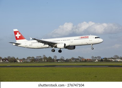 AMSTERDAM, THE NETHERLANDS - MAY, 7. An Airbus A321-111 of Swiss International Airlines lands at Amsterdam Airport Schiphol (The Netherlands, AMS) on May 7, 2015. The name of the runway is Polderbaan.