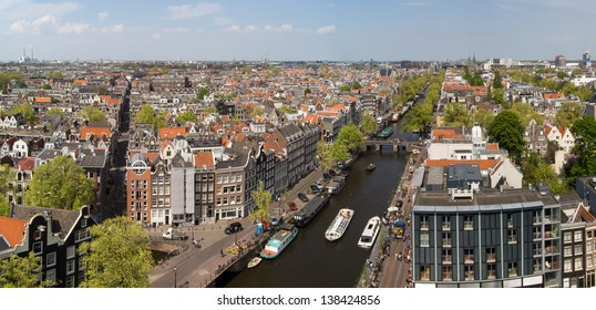 AMSTERDAM, NETHERLANDS - MAY 7: Panoramic view at the Prinsengracht and the Anne Frank House on May 7, 2013 in Amsterdam. The Prinsengracht is the fourth and longest of the main canals in Amsterdam.