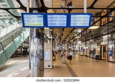 AMSTERDAM, NETHERLANDS - MAY 9: Arrival Departure Board at new back entrance of Amsterdam Central Railway Station, Amsterdam, Netherlands on May 9, 2016. The new back entrance opened in 2015.