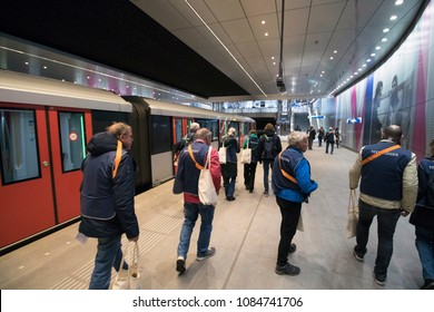 AMSTERDAM , THE NETHERLANDS – MEI 1 , 2018 :test travelers on the perron for the new north-south metro line  Of which the official opening after years of building