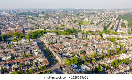 Amsterdam, Netherlands. Museum ( Rijksmuseum ). The building of the XIX century. Flying over the rooftops of the city, Aerial View
