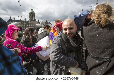 Amsterdam, The Netherlands, Noord Holland - Saturday, April 4 2015 - Pillow Fight on Dam Square as part of the international pillow fight day held in several cities in the world