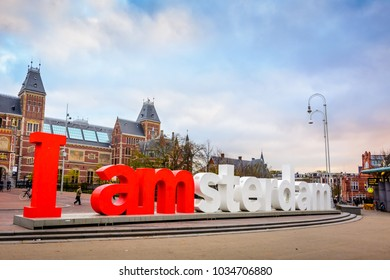 AMSTERDAM, THE NETHERLANDS - NOV 2, 2017: I amsterdam sign located at the back of Rijksmuseum (National State Museum), a city icon and popular tourist attraction in Amsterdam's Museumplein at dawn.