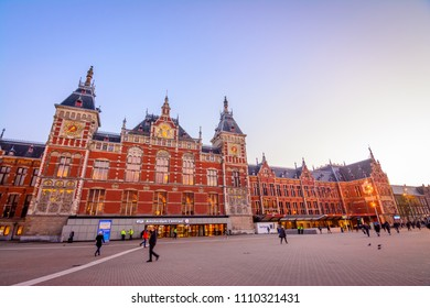 AMSTERDAM, THE NETHERLANDS - NOV 2, 2017: Amsterdam Centraal is the largest railway station, major national railway hub, second-busiest railway station, and Netherlands' most visited heritage site.