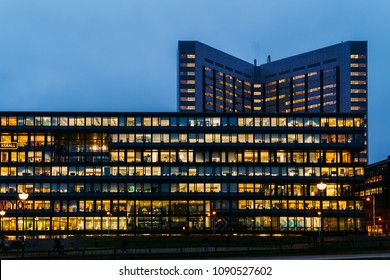 AMSTERDAM, NETHERLANDS - NOVEMBER 08, 2017: Busy Office Buildings During Night In Amsterdam City