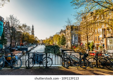 AMSTERDAM, NETHERLANDS - NOVEMBER 08, 2017: Bicycles and Dutch Houses On Amsterdam Canal In Autumn