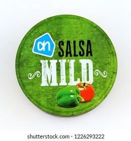 Amsterdam, The Netherlands - November 10, 2018: Cap of a Albert Heijn AH Salsa mild dip sauce jar against a white background.