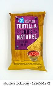 Amsterdam, The Netherlands - November 10, 2018: Package of AH Tortilla chips naturel