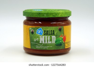 Amsterdam, The Netherlands - November 10, 2018: Albert Heijn AH Salsa mild dip sauce jar against a white background.