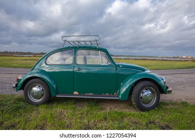 AMSTERDAM, NETHERLANDS - NOVEMBER 11, 2018: A dark green German engineering oldtimer classic car Volkswagen Käfer, or Volkswagen Beetle from 1969 in Original condition and patina