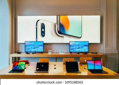 AMSTERDAM, NETHERLANDS - NOVEMBER 13, 2017: iPhone Mobile Phones and iPad Tablets For Sale in Apple Store