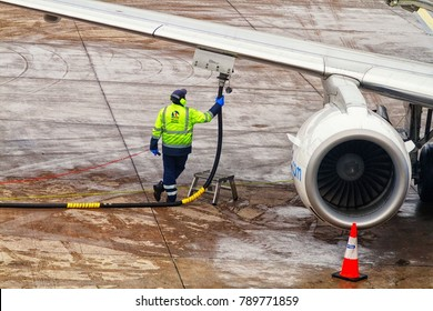 AMSTERDAM, NETHERLANDS - NOVEMBER 13, 2017: Plane is being refilled with fuel for a next flight. Amsterdam Schiphol airport, Netherlands
