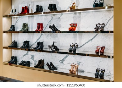 AMSTERDAM, NETHERLANDS - NOVEMBER 14, 2017: Wide Selection Of Women Shoes In Shopping Mall Store Inside
