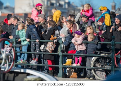 Amsterdam. Amsterdam, The Netherlands - November 18, 2018: People (children, parents) waiting for the arrival (intocht) of Sinterklaas and Black Petes (Zwarte Pieten) on the Skinny Bridge (Magere Brug