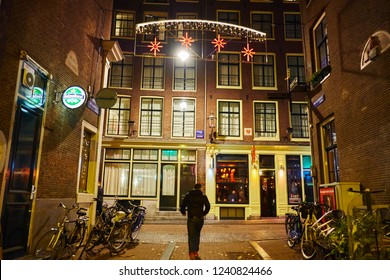 AMSTERDAM, NETHERLANDS - NOVEMBER 18, 2018:  Beautiful streets of the old city at night