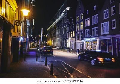 AMSTERDAM, NETHERLANDS - NOVEMBER 19, 2018: Rusland street where is located the Radisson Blu Hotel and Coffeeshop Rusland