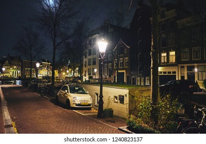 AMSTERDAM, NETHERLANDS - NOVEMBER 19, 2018: View of streets and canals in the city center at night