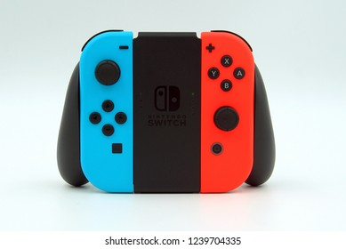 Amsterdam, the Netherlands - November 20, 2018: Nintendo Switch Joy-con controller against a white background.