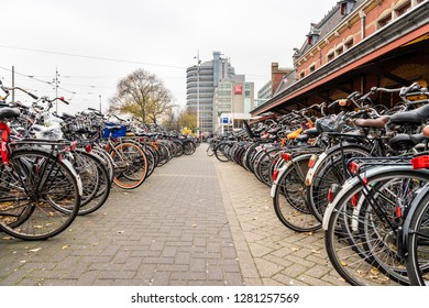 AMSTERDAM, NETHERLANDS - NOVEMBER 22,  2018: Outdoor perspective view of a large bicycle parking next to the Central train station in Amsterdam Netherlands November 22, 2018.