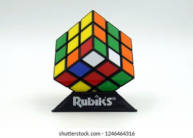 Amsterdam, the Netherlands - November 30, 2018: Unsolved Rubik's cube against a white background.