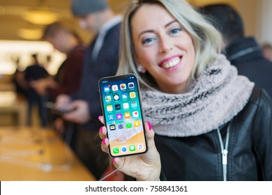AMSTERDAM, NETHERLANDS - November 6, 2017: Girl showing iPhone X in Apple Store.