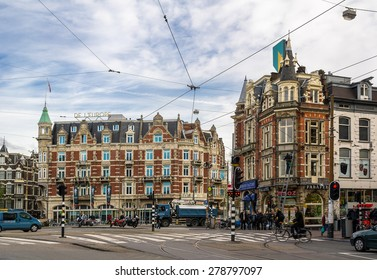 AMSTERDAM, NETHERLANDS - NOVEMBER 7: The famous Muntplein square in Amsterdam, Netherlands with old historical buildings and traffic. The image was taken on November 7, 2013.