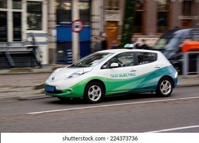 AMSTERDAM, NETHERLANDS - NOVEMBER 8: Electrical taxi car Nissan Leaf in capital citty of Netherlands, Amsterdam, on November 8, 2013. The fleet of these electrical taxis is driven in Amsterdam.