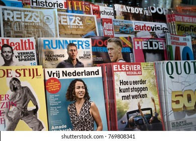 AMSTERDAM, THE NETHERLANDS - NOVEMHER 19,2017: Various magazines in a kiosk: playboy, quote, lifestyle, travel, cars, women, healt, runners. on november 19 , 2017 in Amsterdam, Holland