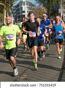 AMSTERDAM, THE NETHERLANDS - OCT 15, 2017: Unidentified recreational athletes participate in the annual Amsterdam Marathon, in the city's streets