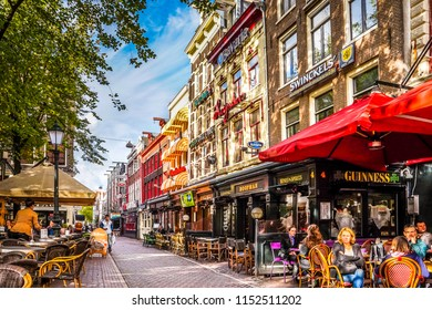 Amsterdam, the Netherlands - Oct. 20, 2014: Lunch time on one of the many terraces at Leidseplein, in the center of Amsterdam on a nice fall day