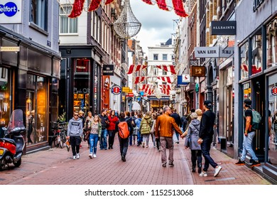 Amsterdam, the Netherlands - Oct. 20, 2014: The busy Kalverstraat, a famous shopping street in the center of the old city of Amsterdam on a nice fall day