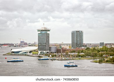 AMSTERDAM, THE NETHERLANDS - OCTOBER 02, 2017: View to waterfront, the EYE Film Museum and Adam Tower. Ferries crossing the IJ river.
