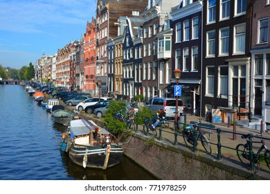AMSTERDAM NETHERLANDS OCTOBER 03 2015 :Canal in Amsterdam has been called the Venice of the North for its more than 100 KM kilometers of canals, about 90 islands and 1,500 bridges