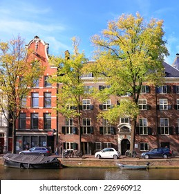 AMSTERDAM, NETHERLANDS, OCTOBER, 10: Amsterdam canal street traditional dutch colorful buildings, Netherlands, October 10, 2014