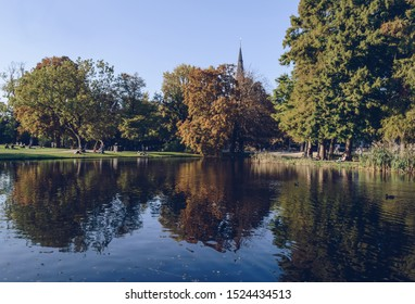 Amsterdam, The Netherlands, October 11, 2018: people relaxing on the grass near lake in Vondelpark