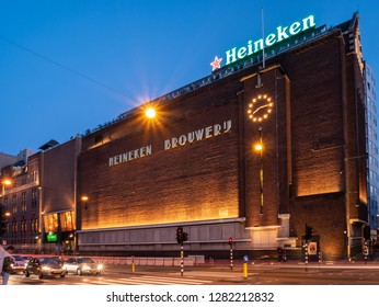 Amsterdam, Netherlands - October 15 2018: Early evening traffic passes by the Heineken Experience in Amsterdam.