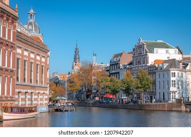 AMSTERDAM, THE NETHERLANDS - October 17, 2018: Canal in Amsterdam with a view between Kloveniersburgwal, Rokin and Amstel river near luxurious L Europe Hotel, Netherlands.