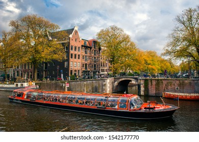 Amsterdam, Netherlands - October 19, 2019: Beautiful canal houses  in the old center of Amsterdam in The Netherlands