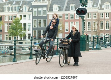 Amsterdam, The Netherlands - October 20, 2018: People and bicycle on the Skinny Bridge (Magere Brug) over the river Amstel.