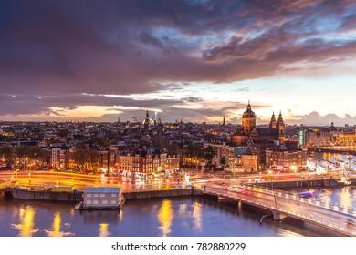 Amsterdam, Netherlands - October 21, 2017: Spectacular colorful night skyline of Amsterdam