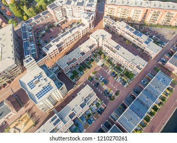 AMSTERDAM, NETHERLANDS - OCTOBER 23, 2018: Aerial drone shoot of a newly constructed Vinex residential area in Amsterdam Oost with individual family houses in a row with gardens and parking area's