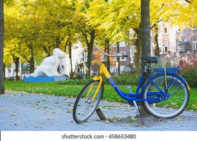 AMSTERDAM, THE NETHERLANDS - OCTOBER 27, 2015: OV-fiets rental bycicle in a park on 27 October, 2015 in Amsterdam, The Netherlands. With subscription one can rent the bike on a regular basis.