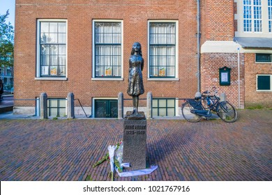 Amsterdam, Netherlands - October 7, 2017: Statue of Anne Frank by Pieter d'Hont, next to Anne Frank Huis.