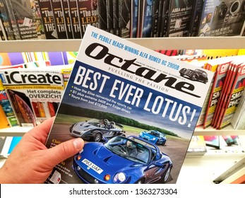 AMSTERDAM, NETHERLANDS: - OCTOBER 8, 2018: Octane magazine in a hand over a stack of magazines. Octane is a British monthly car magazine