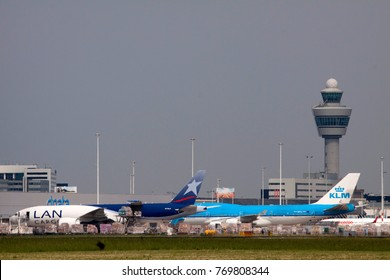 AMSTERDAM, THE NETHERLANDS - OKTOBER 14,2017: Parked boeing 777 from lan cargo and a boeing 747 from the klm on schiphol cargoon oktober 14 , 2017 in Amsterdam, Holland