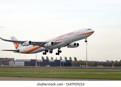AMSTERDAM, THE NETHERLANDS - OKTOBER 5, 2016: Single Airbus A340 from Surinam Airways takes off from the runway at Schiphol Airport.